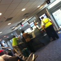Photo taken at Gate D60 by Chris R. on 4/25/2012