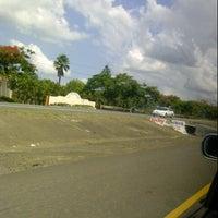 Photo taken at Autopista duarte by Alejandro R. on 7/28/2012