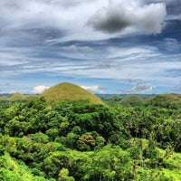 Photo taken at The Chocolate Hills by Jake B. on 5/12/2012