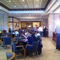 Photo taken at Delta Sky Club by Thomas S. on 6/19/2012