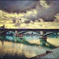 Photo taken at Isabel II Bridge 'Triana Bridge' by Pedro José M. on 4/1/2012
