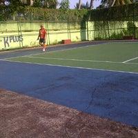 Photo taken at Lapangan Tenis P & K Plus by Yudo A. on 7/29/2012