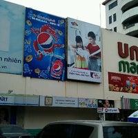 Photo taken at Unimart by Yuji S. on 4/22/2012