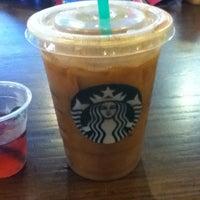 Photo taken at Starbucks by Joelle Q. on 8/11/2012