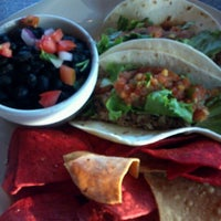 Photo taken at Pleasant City Wood Fired Grill by Jenny D. on 7/28/2012