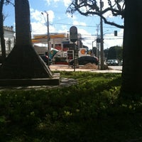 Photo taken at Praça Miguel Couto (Pracinha do Batel) by Thiago K. on 8/16/2012