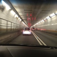 Photo taken at Holland Tunnel Toll Plaza by Zebbie J. on 7/23/2012