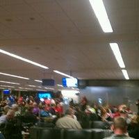 Photo taken at Gate D2 by Jeremy H. on 4/16/2012