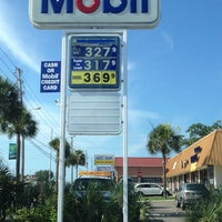 Photo taken at Mobil by Edie M. on 6/11/2012