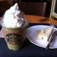 Photo taken at Starbucks by sujing y. on 6/28/2012