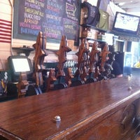 Photo taken at Dogfish Head Brewings & Eats by Eric D. on 6/8/2012