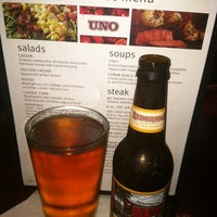 Photo taken at Uno Pizzeria & Grill by Denise F. on 5/9/2012