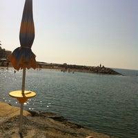 Photo taken at Spiaggia Santo Stefano Al Mare by alessandro s. on 6/17/2012