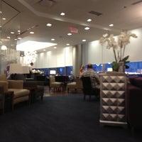 Photo taken at British Airways Galleries Lounge by Charles L. on 6/29/2012