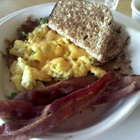 Photo taken at Big Wave Cafe by Jill M. on 3/21/2012
