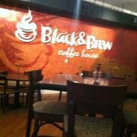 Photo taken at Black & Brew Coffee House & Bistro by Michael V. on 3/23/2012