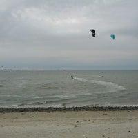 Photo taken at Plumb Beach by Bob D. on 3/24/2012