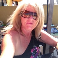 Photo taken at Blue Moon Beach Cafe by Christine G. on 3/16/2012