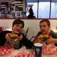 Photo taken at 25 Burgers by Dan N. on 4/14/2012