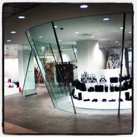Photo taken at COMME des GARÇONS 青山店 by Chie S. on 5/27/2012