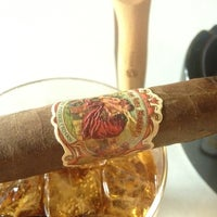 Photo taken at Outman Cigars & Martini Bar by Phil Y. on 9/6/2012