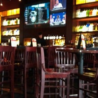 Photo taken at BJ's Restaurant and Brewhouse by Nikki S. on 7/9/2012
