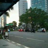 Photo taken at Bus Shelter SCBD by ★Melanie ★. on 5/2/2012