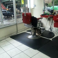 Photo taken at Dominguez Barbershop by Jose M. on 8/10/2012