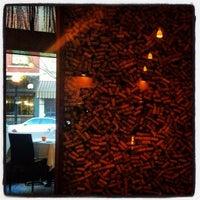 Photo taken at Bacaro Wine Lounge by Charlie R. J. on 4/12/2012