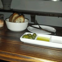Photo taken at Aroma Kitchen & Wine Bar by Cate P. on 7/3/2012