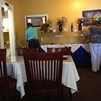 Photo taken at Kashmir Indian Restaurant by Beth H. on 8/8/2012