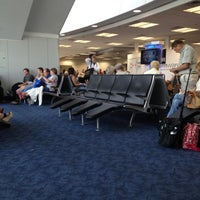 Photo taken at Gate C31 by Adam D. on 8/15/2012