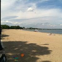 Photo taken at Calf Pasture Beach by gretchen c. on 6/9/2012