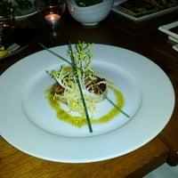 Photo taken at Blowfish Restaurant & Sake Bar by Kevin C. on 7/27/2012