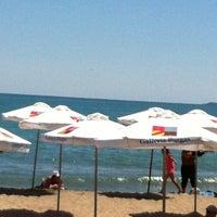 Photo taken at Северен Плаж (North Beach) by Ayse A. on 7/3/2012
