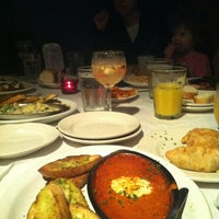 Photo taken at Tango Argentinean Grill by Craig S. on 3/24/2012