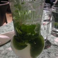 Photo taken at Mojitos Cuban Restaurant by Cynthia R. on 3/23/2012