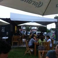 Photo taken at Torino Pizza Bar by Gabriela V. on 7/6/2012