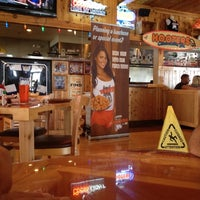 Photo taken at Hooters by Sergio L. on 8/19/2012