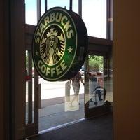 Photo taken at Starbucks by Tade O. on 5/19/2012