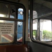 Photo taken at Andén Tren Urbano (Universidad Latina) by Karen J. on 4/26/2012
