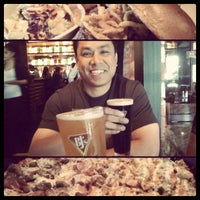 Photo taken at BJ's Restaurant and Brewhouse by Angela T. on 4/28/2012