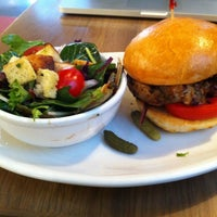 Photo taken at Colossal Cafe by Jeremy W. on 2/21/2012