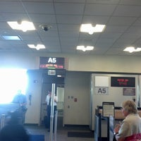 Photo taken at Gate A5 by Tom D. on 8/21/2012