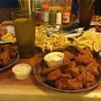 Photo taken at Hooters by Jay Y. on 4/5/2012