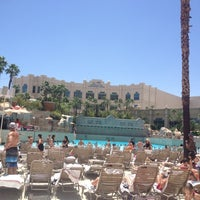 Photo taken at Mandalay Bay Beach by Tiana T. on 6/15/2012