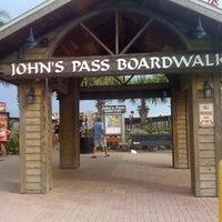 Photo taken at John's Pass Village and Boardwalk by Natasha R. on 8/3/2012