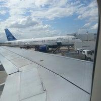 Photo taken at JetBlue Flight 398 by Felicia D. on 9/12/2012