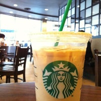 Photo taken at Starbucks by Pamornphol V. on 3/30/2012
