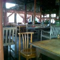 Photo taken at Rumah Kayu Resto & Cottage by Haniah A. on 6/28/2012